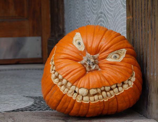 Creepy Toothy Smile Carved Pumpkin Photo Source