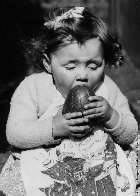 Little girl getting messy with her chocolate Easter Egg (Photo by Fox Photos/Getty Images). 17th March 1938 Photo Source