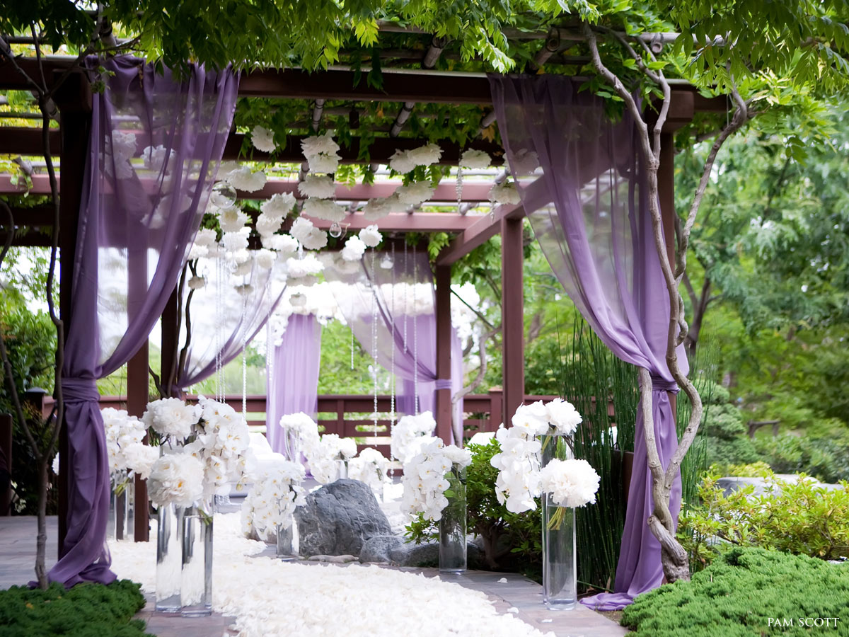 purple-free-standing-pergola-decor_indoor-wedding-garden_white-rose-petal-aisle_white-hanging-flower_
