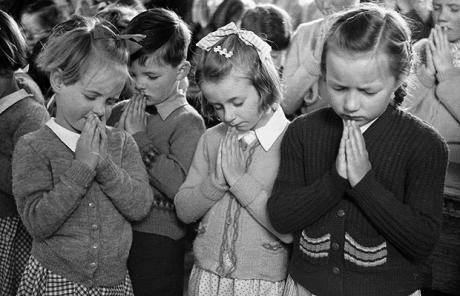 School Prayers...20th June 1953: Two of the 5-year-old Good quadruplets from a village near Bristol, saying their prayers at Westerleigh School. Original Publication: Picture Post - 6547 - The Quads Go To School - pub. 1953 (Photo by Kurt Hutton/Picture Post/Getty Images)
